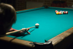 Playing billiards. Man playing billiards on the Green table royalty free stock image