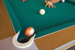 Playing billiards. With balls on a green felt table Stock Photos