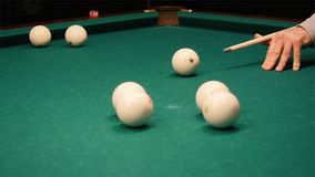 Playing billiards. Clip. Blowing a cue on the ball, the ball hit the pocket, the ball did not hit the pocket, billard stock photo