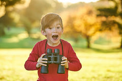 Playing with Binoculars royalty free stock photography