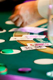 Playing Black Jack. Dealer's hands at a black jack table Royalty Free Stock Images