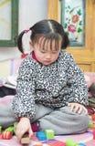Playing block of Chinese girls. North sitting on the Kang playing block of Chinese female Stock Photos
