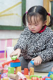 Playing block of Chinese girls 02. North sitting on the Kang playing block of Chinese female Royalty Free Stock Images