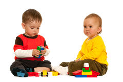 Playing with blocks two toddlers Stock Photo
