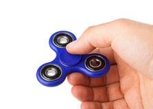 Playing with a blue Fidget Spinner stock photos