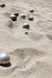 Playing of bocce in the sand Royalty Free Stock Photography