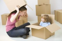 Playing with boxes Stock Photos