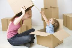 Playing with boxes Royalty Free Stock Photos