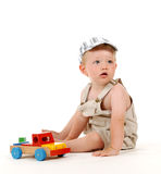 Playing boy. Boy playing with a toy Royalty Free Stock Photos