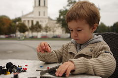 Playing boy. A boy playing with a toy Royalty Free Stock Photo