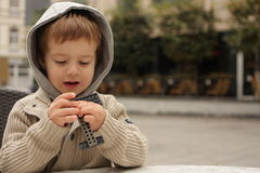 Playing boy. A boy playing with constructor Royalty Free Stock Images