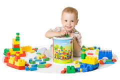 Playing boy. Little boy playing with colorful blocks Stock Photo