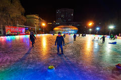 The playing boy on the ice square. The photo was taken in Zhaolin park Harbin city Heilongjiang province,China stock image