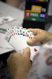 Playing bridge. Detail of a woman playing bridge during a tournament Royalty Free Stock Photography