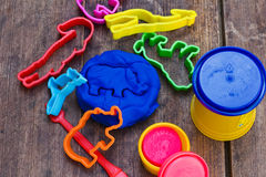 Playing with bright colourful clay dough Royalty Free Stock Image