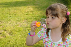 Playing with bubble. Cute little girl playing with bubbles Royalty Free Stock Image