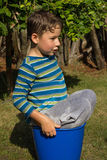 Playing with a bucket of water Royalty Free Stock Images
