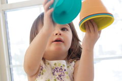 Playing with buckets Stock Photo