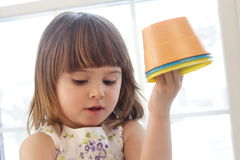 Playing with buckets Stock Photography