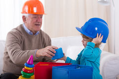 Playing in builders Stock Photos