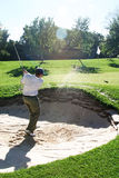 Playing from the bunker. To the green stock photos
