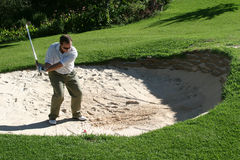 Playing from the bunker. To the green royalty free stock photo