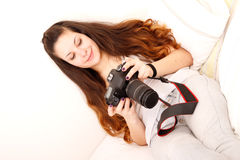 Playing with camera in the bed Stock Photography
