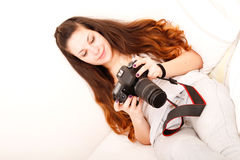 Playing with camera in the bed Royalty Free Stock Photography