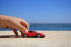 Playing with car. Close-up of a kid hand playing with a racing car stock images