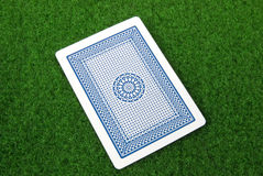 A playing card. On green table Stock Photos