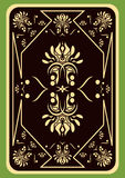 Playing card. The turned playing card on a green background Stock Photo