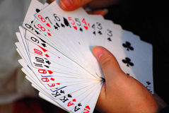 Playing card. Hand holding a stack of cards in china Royalty Free Stock Photos