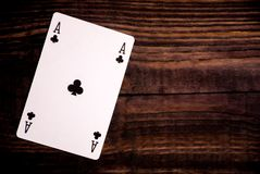 Playing card - ace of cloves - on wood royalty free stock photo