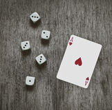 Playing card ace of hearts and game dice background, vintage abstract Stock Image