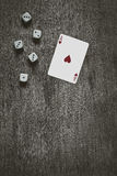 Playing card ace of hearts and game dice background, vintage abstract, top view Royalty Free Stock Photography