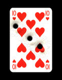 Playing card with bullet holes. Playing card heart ten with three bullet holes Stock Photos