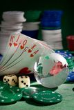 Playing  card  chips, dice, and globe Royalty Free Stock Photography