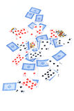 Playing card deck on white. A deck of generic playing cards are spread out on white, some face up, some face down Royalty Free Stock Photos