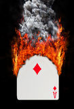 Playing card with fire and smoke Royalty Free Stock Image