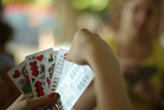 Playing a card game in shallow depth of field Stock Image