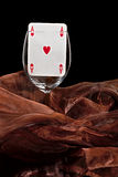 Playing card in the glass Royalty Free Stock Photography