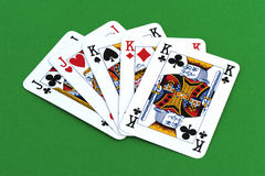 Playing card on green table Royalty Free Stock Photography