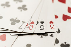 Playing card hand spelling the word lose Royalty Free Stock Photo