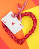 Playing card and heart. royalty free stock photography