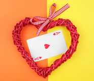 Playing card and heart. royalty free stock images