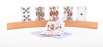 Playing card holder with falling cards. In the foreground Royalty Free Stock Images