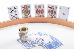 Playing card holder with playing cards. And dollars Royalty Free Stock Photo