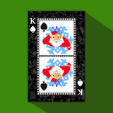 Playing card. the icon picture is easy. peak spide KING. NEW YEAR SANTA CLAUS. CHRISTMAS SUBJECT. about dark region boundary. a. Illustration on a green stock illustration