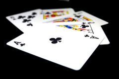 Playing Card Isolated. Five Playing Cards of Black Symbol for Poker on Black Background Royalty Free Stock Photography