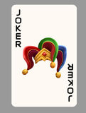 Playing card joker hat. Isolated on gray. Stock Photography
